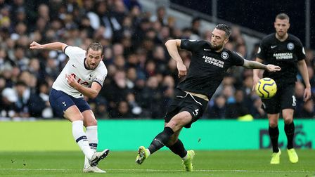 Tottenham Hotspur's Harry Kane (left) and Brighton and Hove Albion's Shane Duffy in action at the To