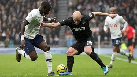 Tottenham Hotspur's Moussa Sissoko (left) and Brighton and Hove Albion's Aaron Mooy battle for the b