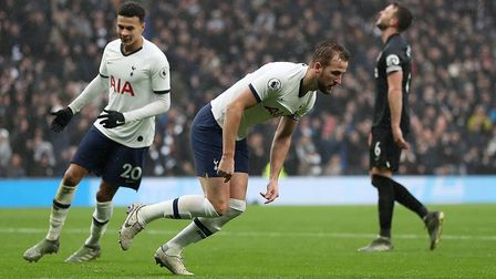 Tottenham Hotspur's Harry Kane turns to celebrate after scoring his side's first goal