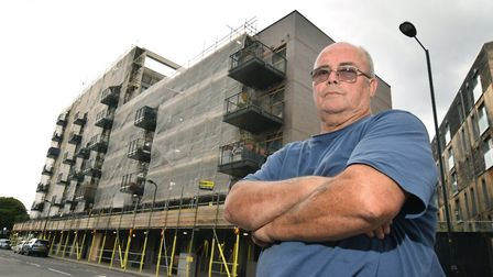 Michael Jones outside Bridport House, which is covered in scaffolding. Picture: Polly Hancock