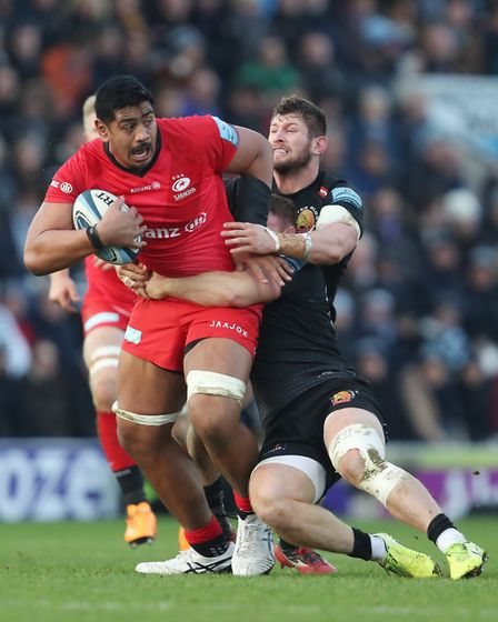 Saracens' Will Skelton is tackled by Exeter's Sam Simmonds