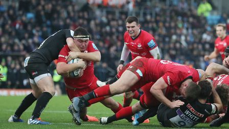 Saracens' Jamie George is held up short of the line by Exeter's Joe Simmonds