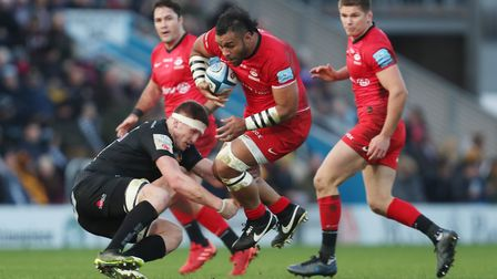 Saracens' Billy Vunipola is tackled by Exeter's Jacques Vermeulen