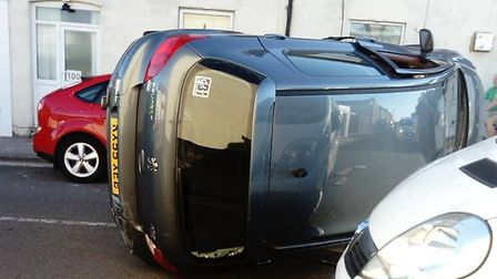 The car which flipped over after an accident on Norwich Road. Picture: Ebony French