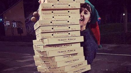 Outside Project volunteer Kate delivers pizza to last year's Outsidermas event. Picture: Carla Ecola