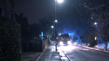 Firefighters stayed to watch for secondary fires at Hornsey Moravian Church overnight. Picture: Adam