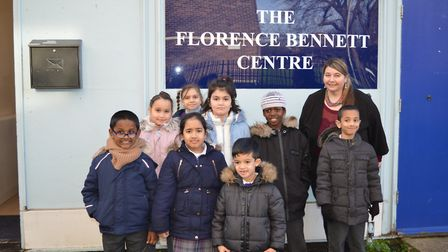 The Olive School pupils visit the Florence Bennett Centre to donate food they collected.