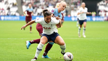 Tottenham Hotspur women's Siri Worm battles for possession of the ball with West Ham United women's