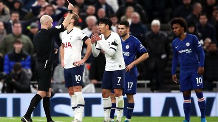 Referee Anthony Taylor shows Tottenham Hotspur's Son Heung-min (centre) a red card following a VAR r