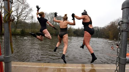 Nicky Schniner, Emma Catto and Jacqueline Palmer take the leap into a chilly Kenwood Ladies' Pond. P