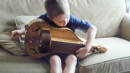 James Larcombe's son Dominic plays the hurdy-gurdy that has been stolen. Picture: James Larcombe