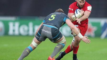 Saracens Calum Clark is tackled by Ospreys Alun Wyn Jones during the Heineken Champions Cup pool fou