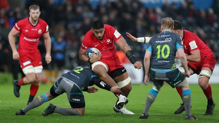 Saracens Will Skelton is tackled by Ospreys Scott Otten during the Heineken Champions Cup pool four