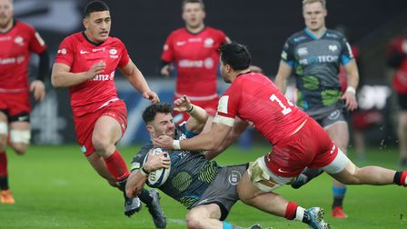 Ospreys Luke Morgan is tackled by Saracens Sean Maitland during the Heineken Champions Cup pool four