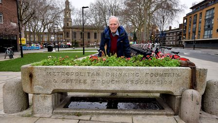 Local historian Peter Hindley with the listed horse trough on Pitfield Steet. The inscription at one