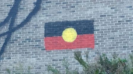 The graffiti at Dalston Kingsland station now features an Aboriginal flag. Picture: Joe Goodman