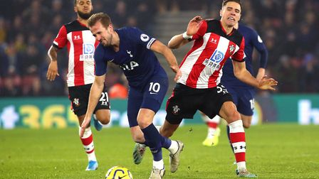Tottenham Hotspur's Harry Kane (left) and Southampton's Jan Bednarek battle for the ball