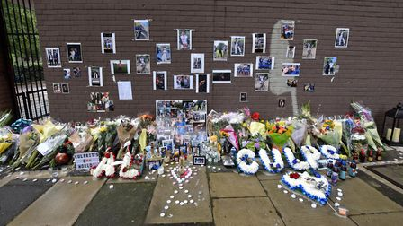 Tributes laid at Munster Square, where Alex Smith was killed. Picture: Polly Hancock