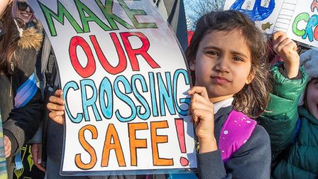 'Make our crossing safe': A young girl protests for improvements to the crossing outside of Martin P