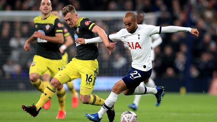 Southampton's James Ward-Prowse (left) and Tottenham Hotspur's Lucas Moura (right) battle for the ba