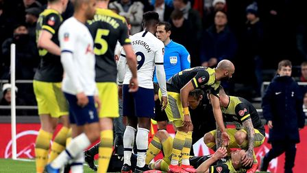 Southampton's James Ward-Prowse (bottom right) receives treatment for an injury during the FA Cup fo