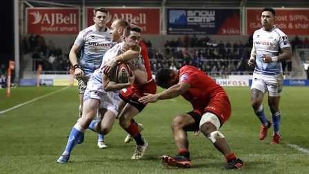Sale Sharks' Luke James receives a high tackle from Saracen's Alex Day during the Premiership Cup se
