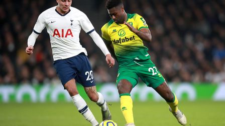 Tottenham Hotspur's Dele Alli (left) and Norwich City's Alexander Tettey battle for the ball during