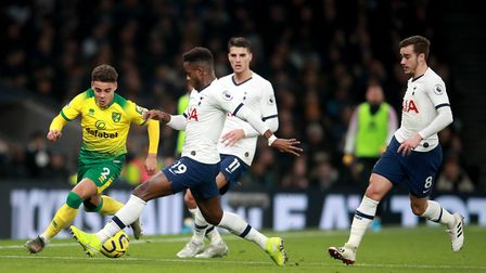 Norwich City's Max Aarons (left) and Tottenham Hotspur's Ryan Sessegnon battle for the ball during t