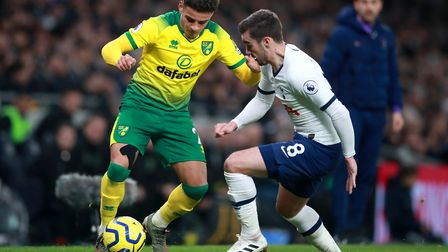 Norwich City's Max Aarons (left) and Tottenham Hotspur's Harry Winks battle for the ball during the