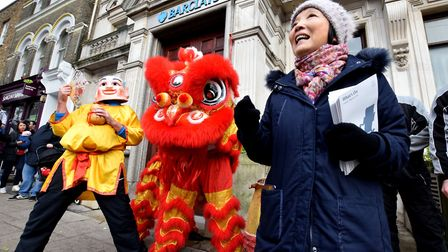 Linda Chung speaks to the crowd in Hampstead for the annual lion dance. Picture: Polly Hancock