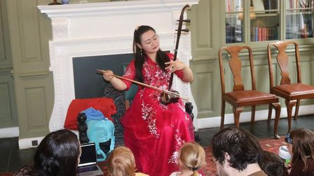 Chen Teng, who enthralled children and families with music on the Erhu, a traditional Chinese instru