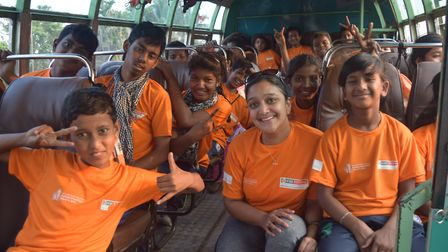 Prize winner Sanju Pal with 'Yearn to Learn' students on a trip back from the Kolkata marathon in 20