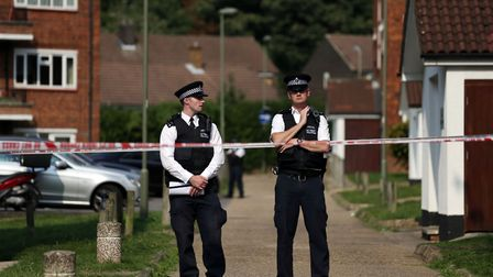 Police officers outside flats in Elmshurst Crescent, East Finchley, where Annie Ekofo, 52, and her n
