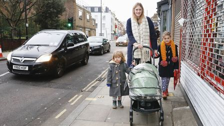 Victoria Lane walking down Stoke Newington Church Street with her two children. Picture: Air Team UK