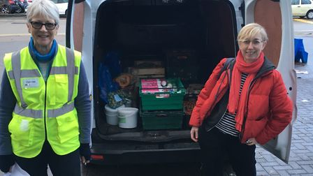 Shiri, right, with a volunteer at the Free Food Larder. Picture: Cooperation Town