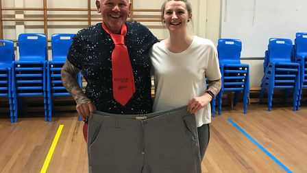 Mark Smith, who has lost 5st in 22 weeks, with Slimming World consultant Tamsyn Ambrose. Picture: Cl
