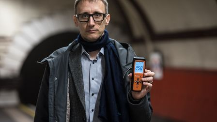 Justin McKie with his PM2.5 monitor in Belsize Park Tube station. Picture: Justin McKie