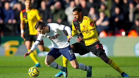 Tottenham Hotspur's Giovani Lo Celso (left) and Watford's Etienne Capoue battle for the ball