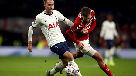 Tottenham Hotspur's Christian Eriksen (left) and Middlesbrough's Lewis Wing battle for the ball