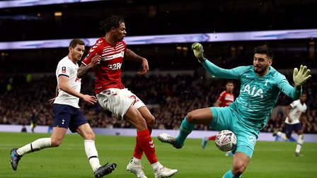 Tottenham Hotspur goalkeeper Paulo Gazzaniga (right) saves from Middlesbrough's Lukas Nmecha