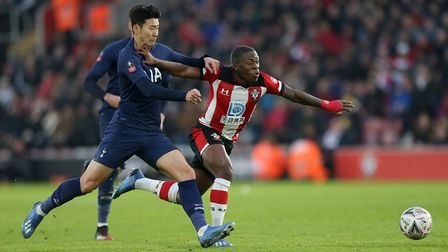 Tottenham Hotspur's Son Heung-min (left) and Southampton's Michael Obafemi battle for the ball