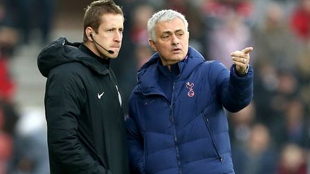 Tottenham Hotspur manager Jose Mourinho (right) speaks with fourth official John Brooks