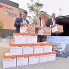 Waveney MP Peter Aldous along with councillors Mark Bee and Matthew Hicks with the 14 boxes of docum