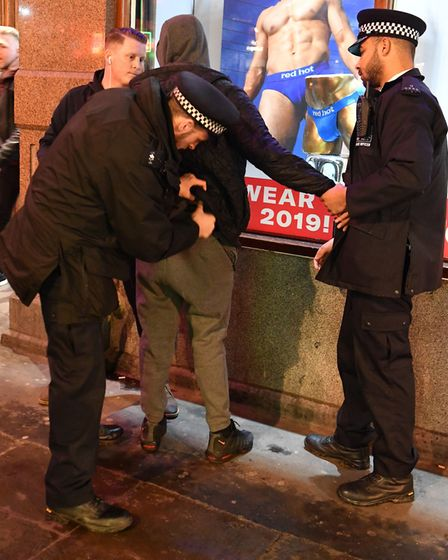 Officers carry out a stop and search on a man who avoided going through a knife arch. Picture: John