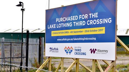 A sign highlighting that the land close to lake Lothing has been acquired for a major third crossing