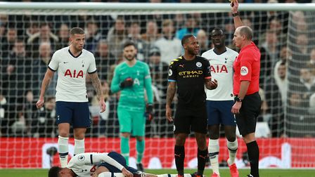 Manchester City's Raheem Sterling is booked for a challenge on Tottenham Hotspur's Dele Alli during