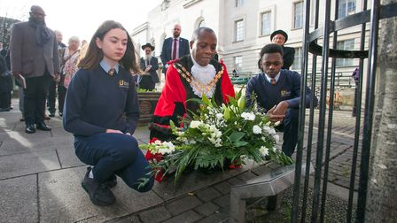 Schoolkids and the Speaker of Hackney laying down flowers at the Holocaust Memorial Tree in the Town