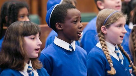 Pupils from Simon Marks Jewish Primary singing at the Holocaust Memorial at Hackney Town Hall. Pictu