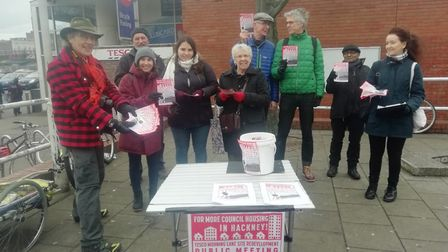 People from the Morning Lane People's Space campaign outside Tesco, which they would like to see red