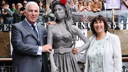 Parents of Amy Winehouse, Mitch and Janice, next to their daughter's statue in Stables Market. Pictu
